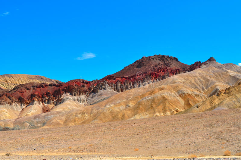 Golden Canyon in Death Valley National Park. Golden Canyon hiking trail in Death Valley National Park in California desert ends up with a giant red mountain royalty free stock photography
