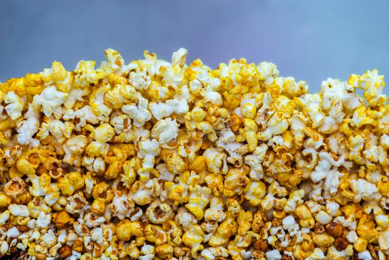 Golden caramel popcorn closeup. Background of popcorn. Snacks and food for a movie royalty free stock photo