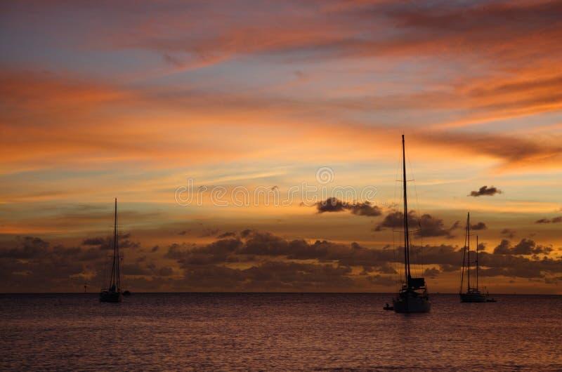 Golden Caribbean Sunset Cruise stock photos