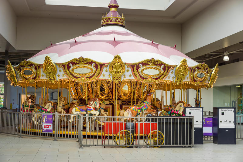 Golden carousel ride. Carousel ride inside the mall providing entertainment for shoppers stock photography