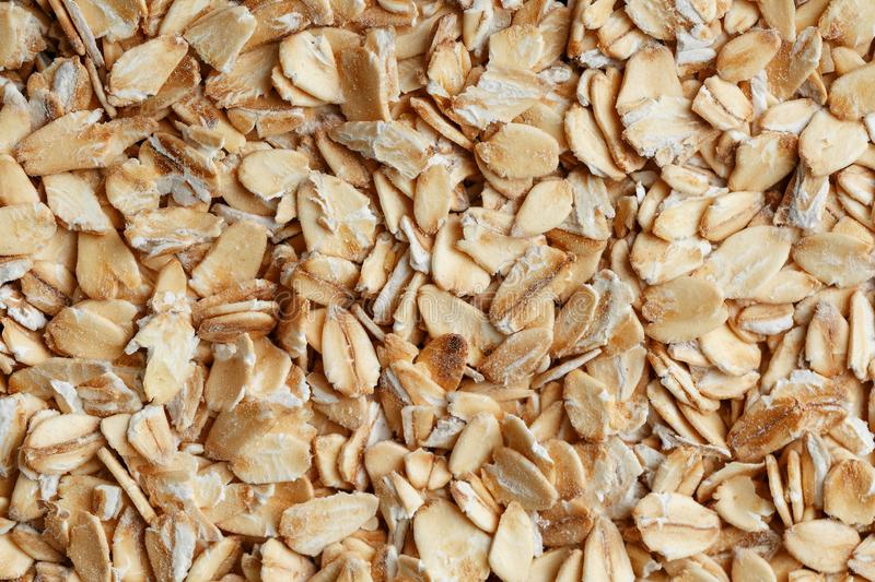 Golden cereal muesli, background and texture. Oatmeal grains. Healthy breakfast Top view. Close-up royalty free stock photos