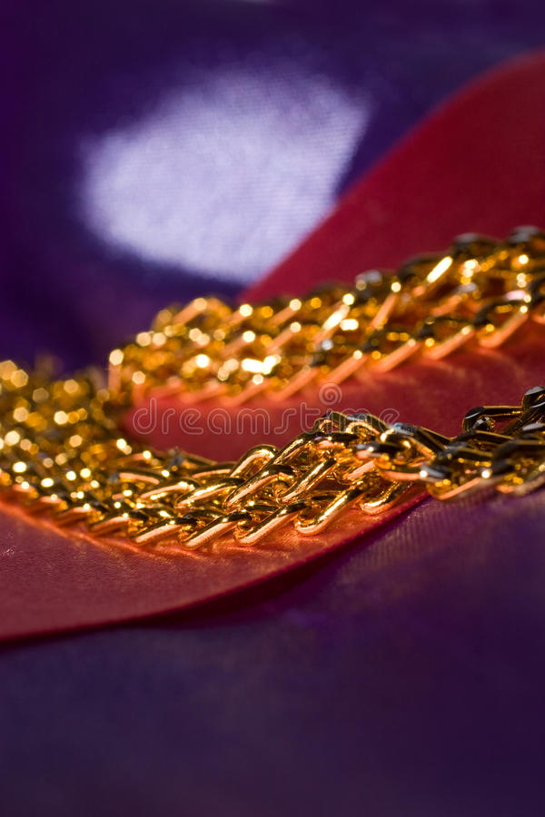 Golden Chain On Shiny Silk Royalty Free Stock Image