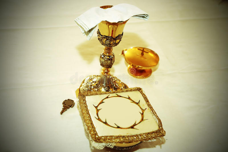 Golden Chalice with consecrated hosts in a Christian Church. During Holy Mass stock photography