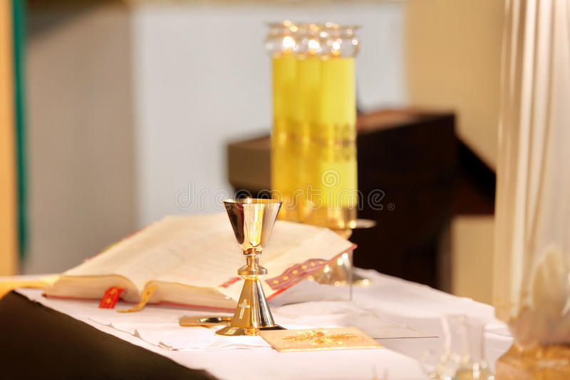 Golden chalices during the mass. Golden chalices on the altar during the mass royalty free stock photo