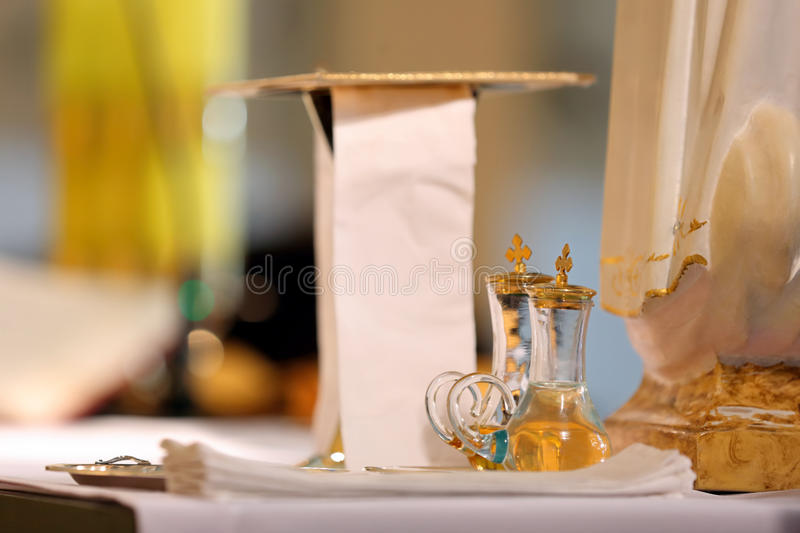 Golden chalices with wine and water before the mass royalty free stock photos