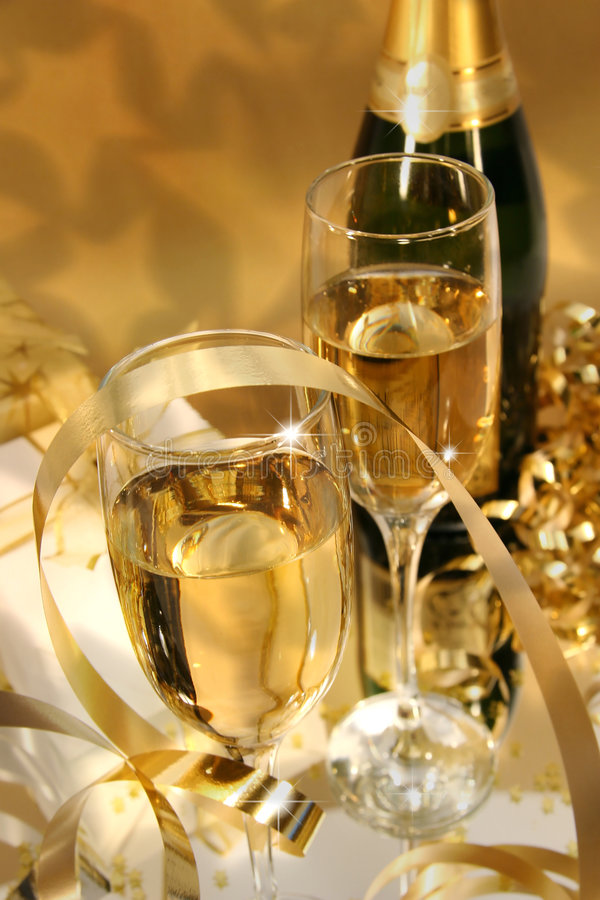 Golden champagne sparkle. Close-up of fluted champagne glass ready for celebrating royalty free stock photography