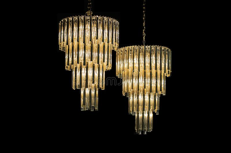 Golden chandelier, glass crystal, on a black background isolate.  stock images