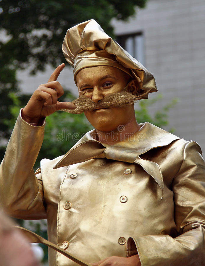Golden chef living statue at the festival of the famous russian travel magazine `Vokrug Sveta`. At this celebration can see traditions of different nations royalty free stock photography
