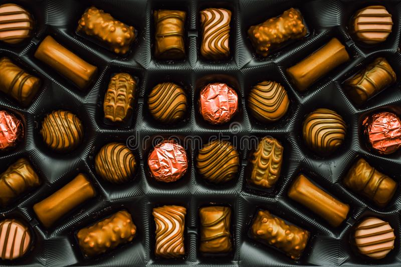 Golden chocolate candies in the box stock image