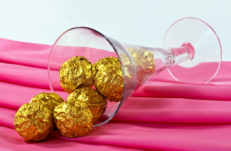 Download Chocolates and glass stock photo. Image of foil, golden - 22738526
