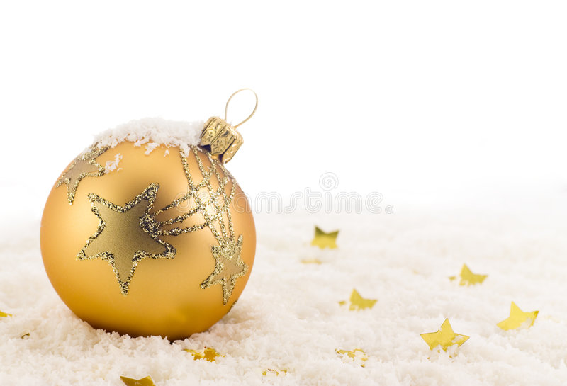 Golden Christmas ball. On snow royalty free stock images