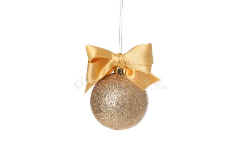 Golden Christmas ball with bow isolated on background. Golden Christmas ball with bow isolated on white background royalty free stock photo