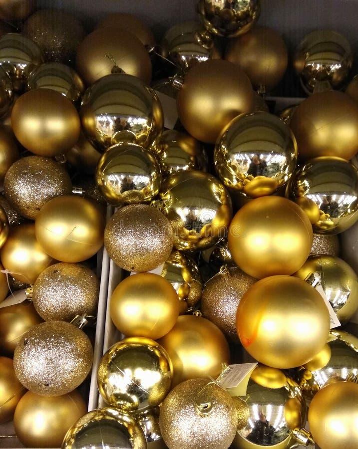 Golden Christmas Ball Ornaments. Shiny holiday background. Festive mood royalty free stock photos