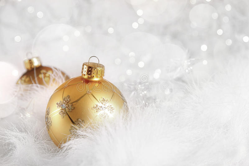 Golden Christmas balls on holiday background royalty free stock photography