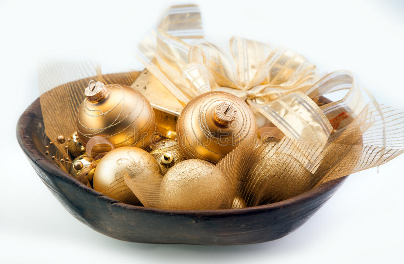 Golden Christmas baubles in a bowl stock photography