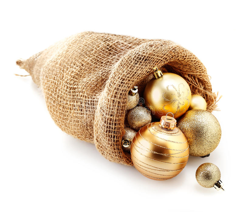Golden Christmas baubles in a hessian bag stock image