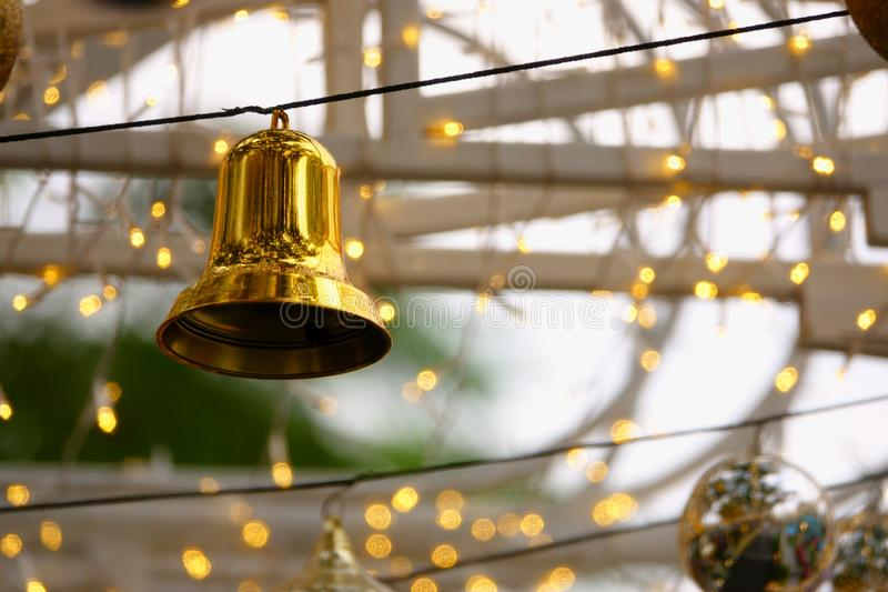 Golden Christmas bell and small lights stock image