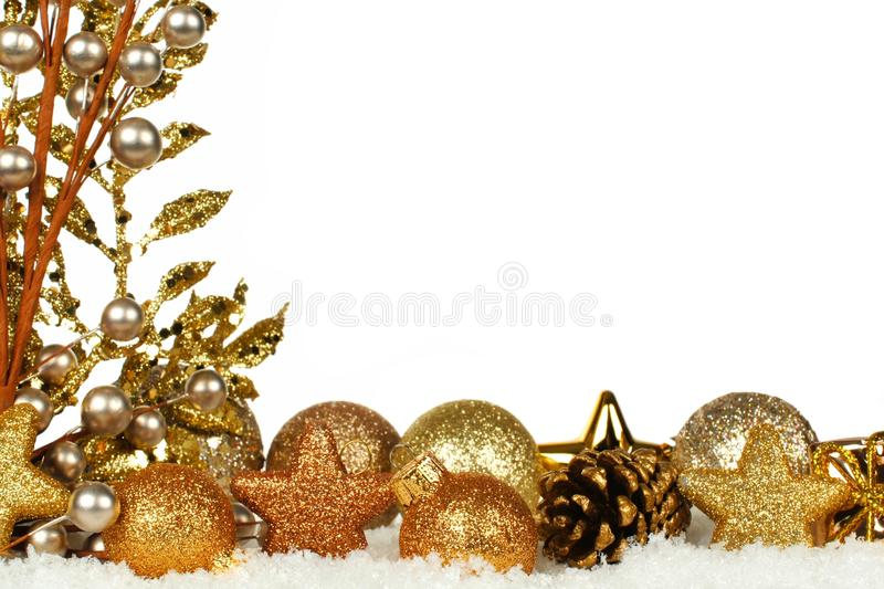 Golden christmas border with ornaments and branches in