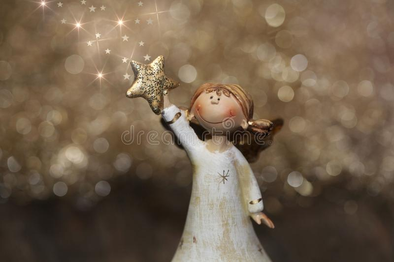 Golden christmas or guardian angel with stars for decoration. Greeting card stock image