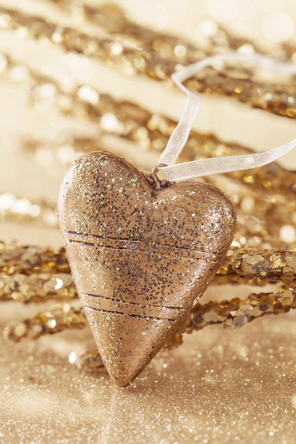 Golden christmas heart. Close up stock images