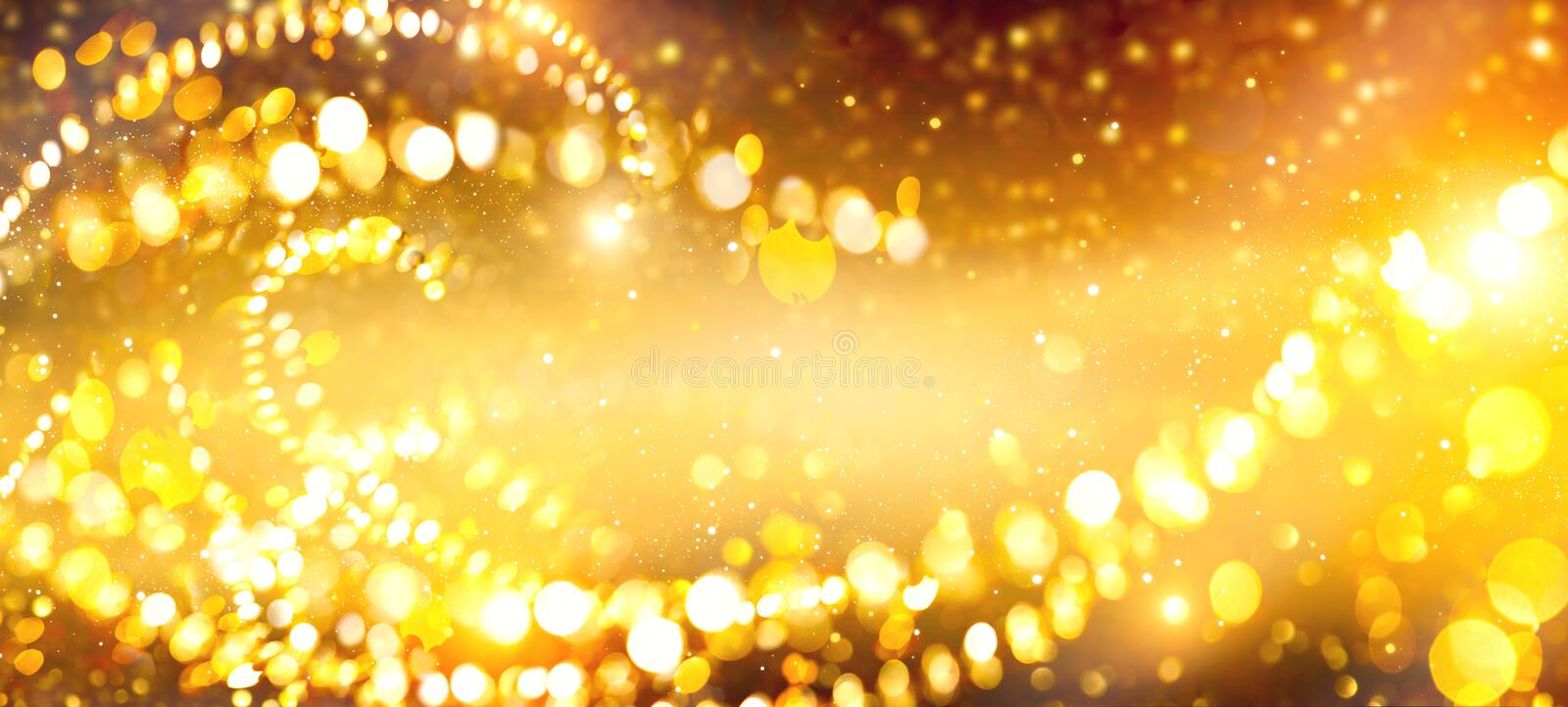 Golden Christmas and New Year glittering stars swirl on black bokeh background, backdrop with sparkling golden star. S, holiday garland, magic glowing dust royalty free stock photos