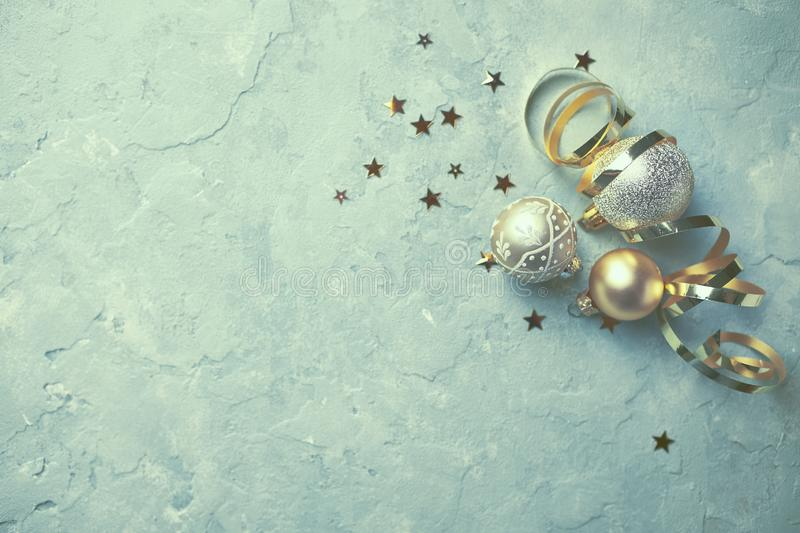 Golden Christmas ornaments on rustic background. Flat lay stock photography