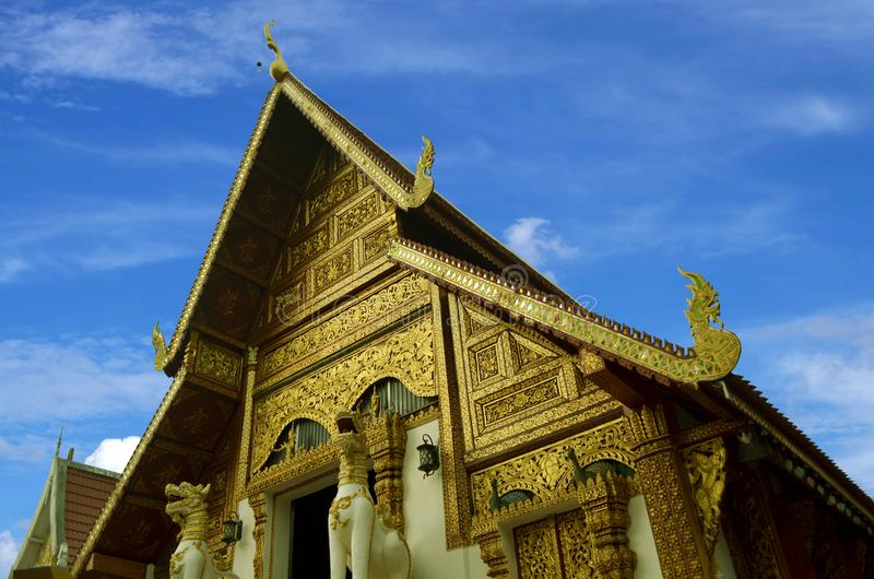 Golden church with blue sky background Old architecture at Wat Phra Singh temple in Chiang Rai. Thailand royalty free stock photos
