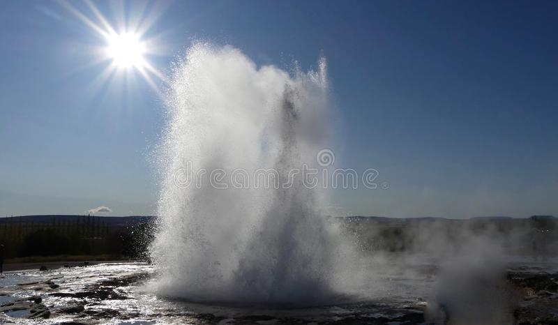 The Golden Circle and Strokkur geysir. Every 3-4 minutes, you will see this magical moment. nGolden Circle - Strokkur geysir in Iceland stock photo