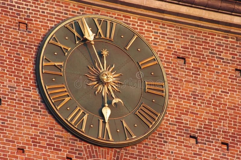 Golden clock in Krakow stock photos