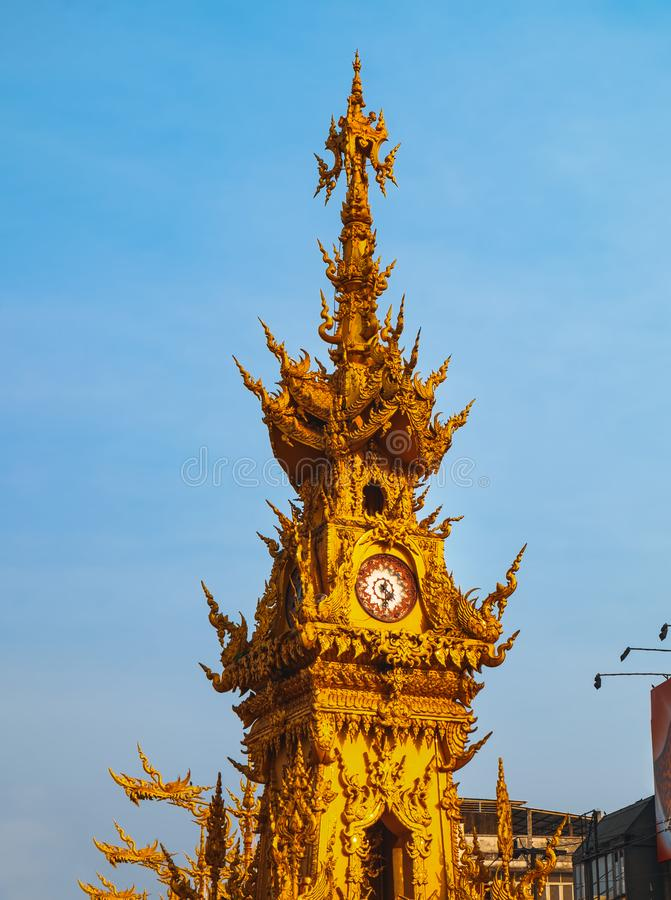 Golden clock tower in Chiang Rai, Thailand stock image