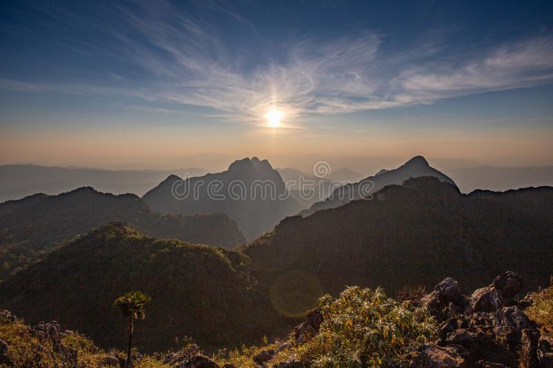 Golden Cloud and sunset sky. At wildlife sanctuary name Doi Luang Chiang Dao, Thailand with Shadow of mountain layer and sun ray stock photo