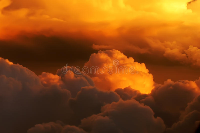 Golden clouds on fire royalty free stock photography