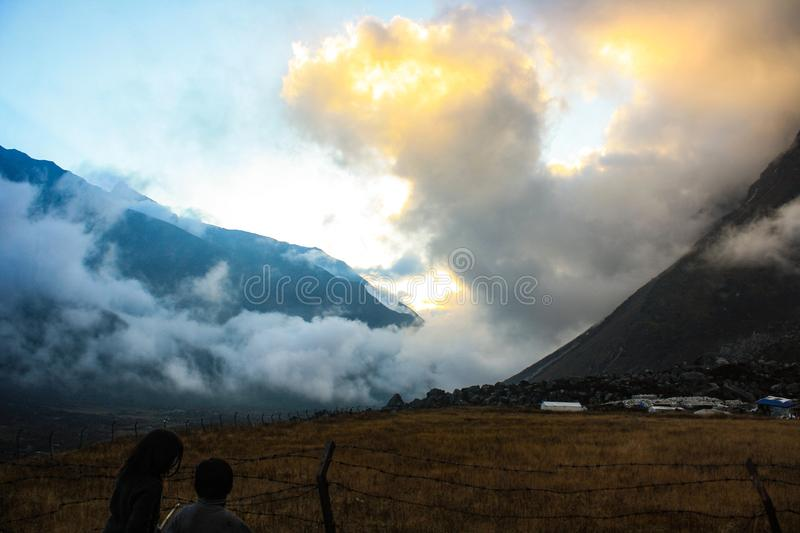 Golden clouds over the Kyanjin Valley royalty free stock photography