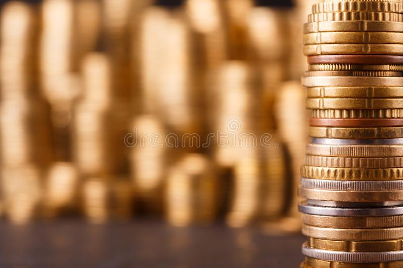 Golden coin stacks, rich money background royalty free stock image