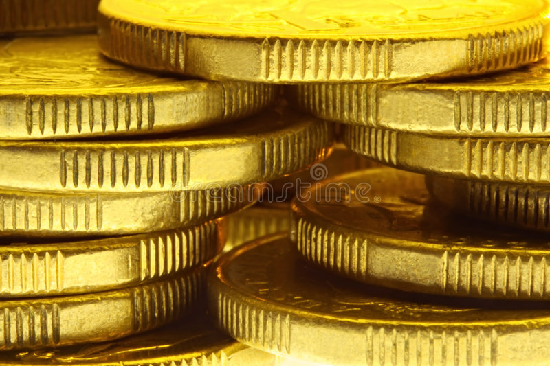 Golden Coins. Stacks of golden coins, in close-up royalty free stock photo