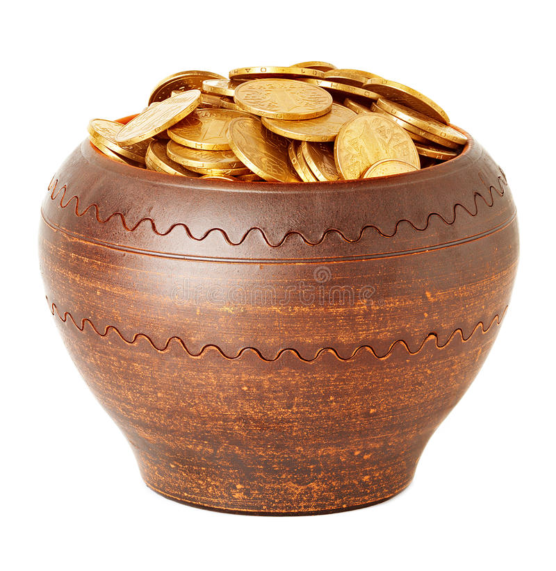 Golden coins in ceramic pot stock photography