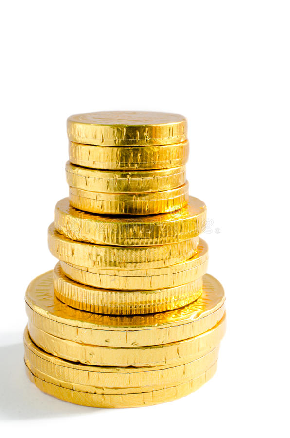 Golden coins. On white isolate background stock image
