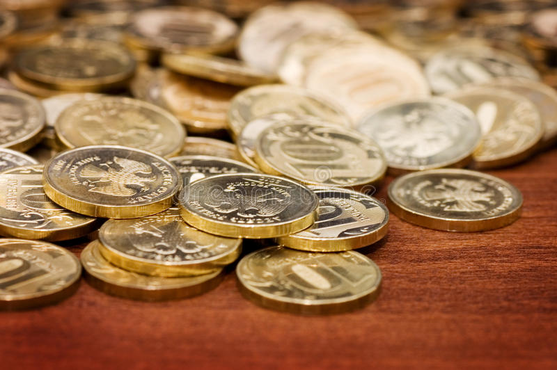 Golden coins on a wooden table
