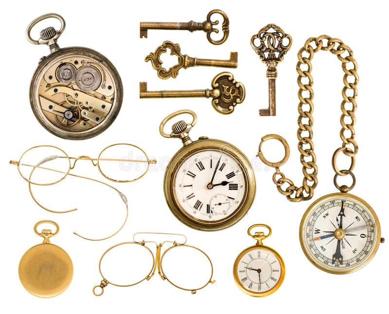Golden collectible accessories. antique keys, clock, glasses, co. Set of golden vintage collectible accessories. antique keys, clock, compass, glasses isolated royalty free stock photography