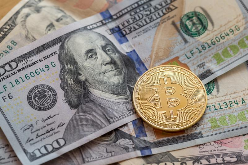 Golden color bitcoin with us dollars royalty free stock images