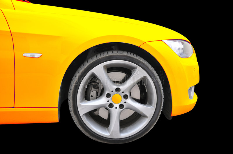Golden color car - tire close up view. Side view of a BMW golden color car - Close up view of nose-tire portion stock photos