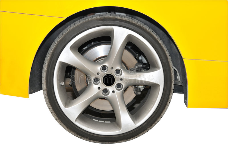 Golden color car - tire close up view. Side view of a BMW golden color car - Close up view of back-tire portion stock photo