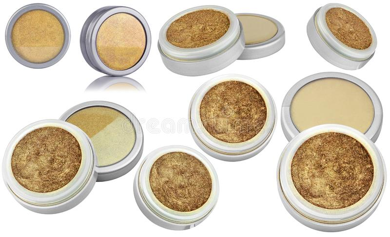 Golden color cosmetic eyeshadow powder with glitter particles, in round grey container, eight different instances and views of. Beauty product isolated on white royalty free stock images