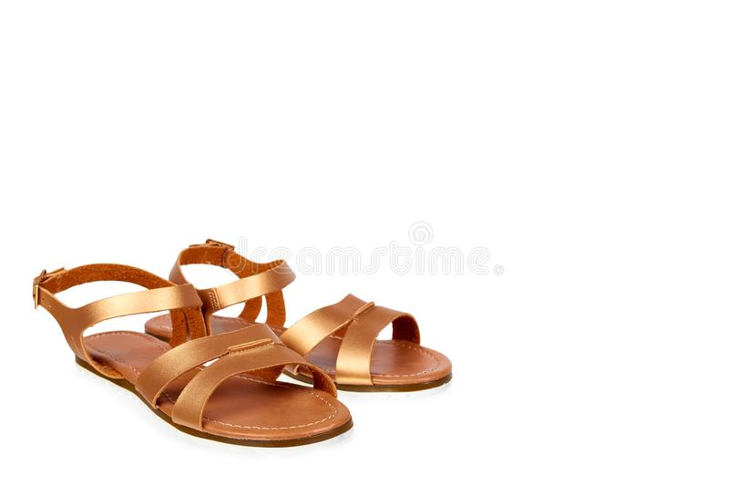 Golden color eco leather sandals isolated on white background, copy space template.  royalty free stock photo