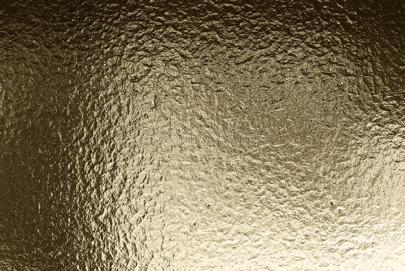 Golden color metal rippled background. Abstract metal texture. 3d illustration.  royalty free illustration
