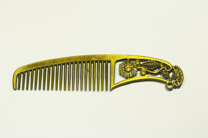 Golden comb royalty free stock photo