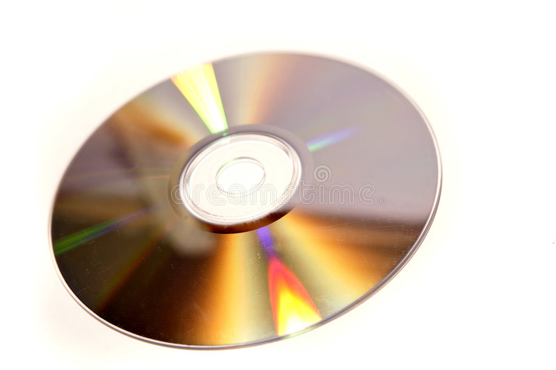 Golden Compact Disc. A background with a view of a golden compact disc, isolated on a white background royalty free stock image