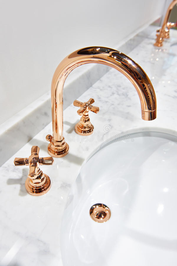 Golden cooper water tap faucet. With hot and cold water royalty free stock photography