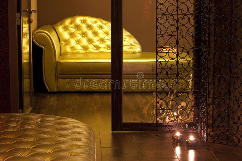 Golden couch in a SPA waiting area. Golden couch in a SPA center waiting area royalty free stock photography
