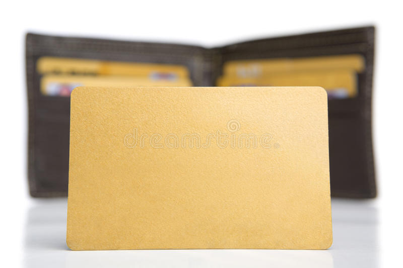 Golden credit card in front of the wallet stock image